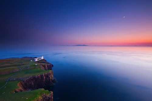 blue ocean sunset-evening-sky-moon-beach-cliff-lighthouse-nature globeattractions.com -